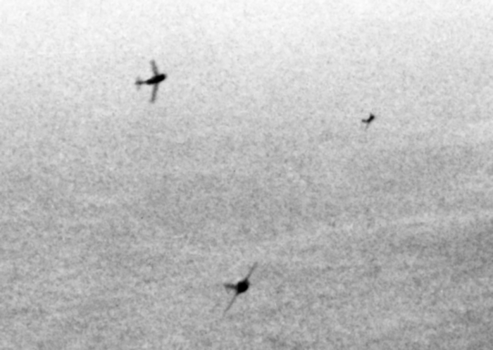 MiG-15s_curving_to_attack_B-29s_over_Korea_c1951