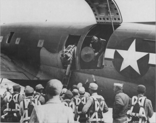 Chinese troops who will be flown to the Burma frontier to fight with General Joseph W. Stilwell's forces board a Curtiss C-46 at Yunnanyi Air Base in China
