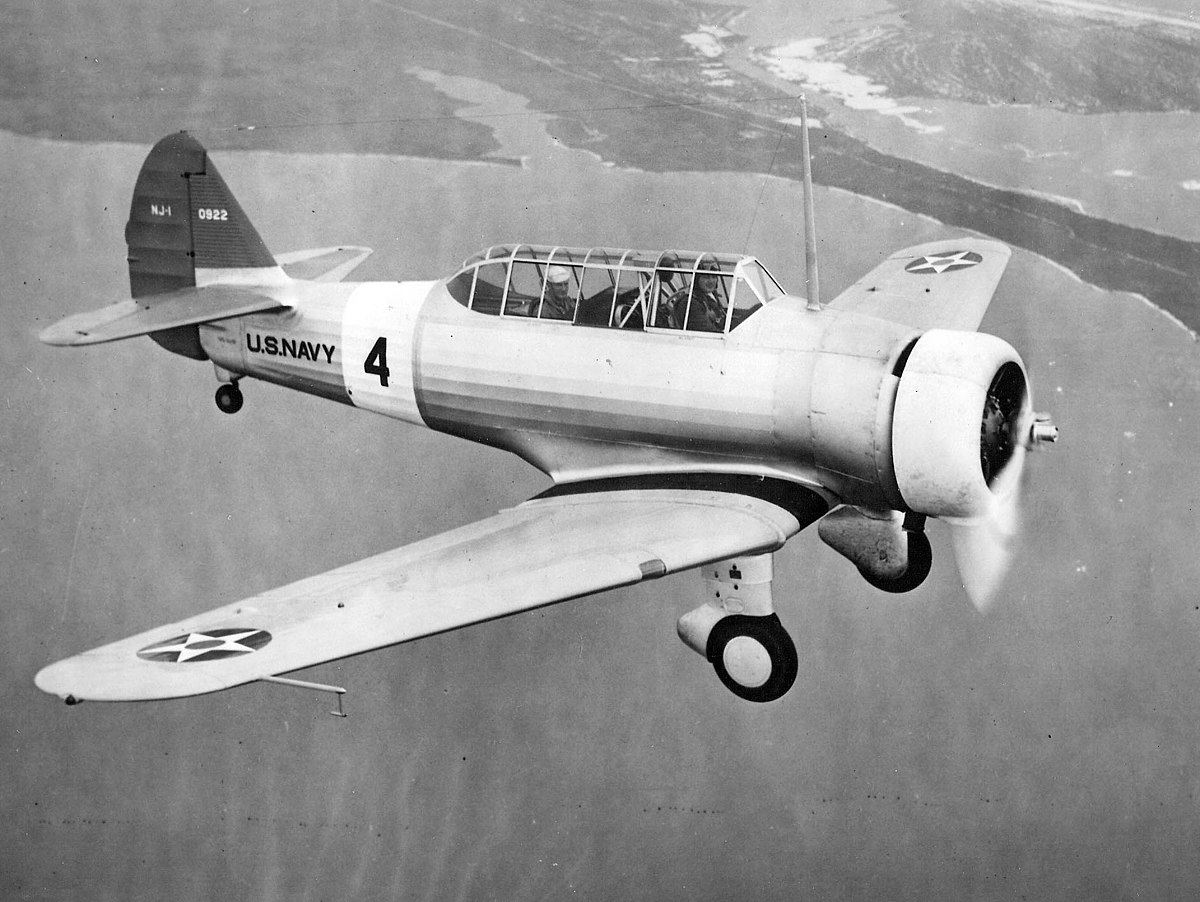 1200px-North_American_NJ-1_in_flight_1938